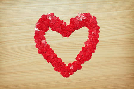 Love heart made with heart-shaped confetti. Valentines Day card. Space for text photo