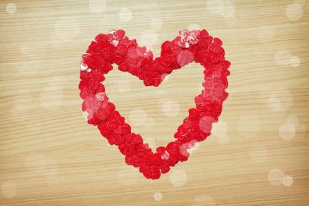 Love heart made with heart-shaped confetti photo