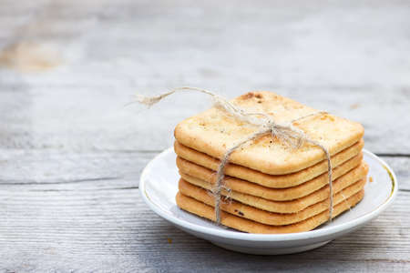 Saltine  crackers on a plate on wooden table photo