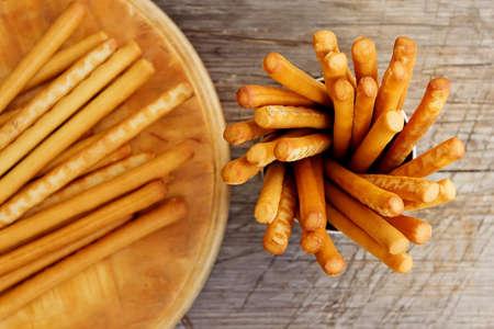 pretzel stick: Breadsticks grissini on wooden background. Top view.
