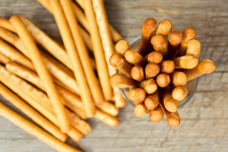 grissini: Breadsticks grissini on wooden background