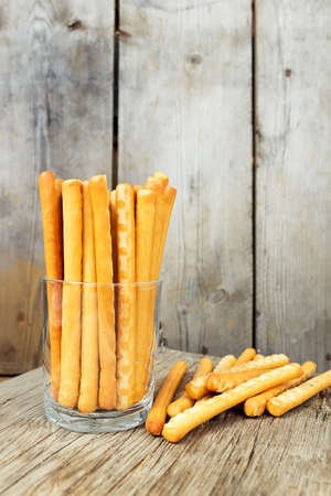 grissini: Bread sticks in a glass. Breadsticks grissini on wooden background Stock Photo