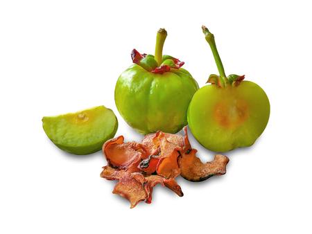 Garcinia atroviridis fruit isolated on a white background Stock Photo