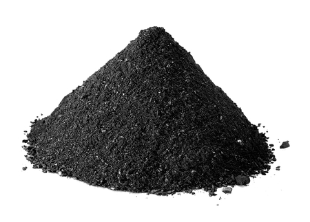 Charcoal powder isolated on white Imagens