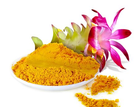 Turmeric powder with flower isolated on white background Stockfoto