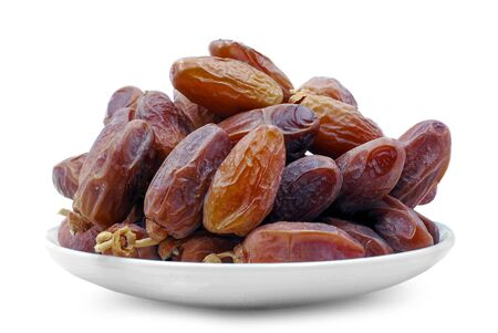 Date palm fruit in plate isolated on white background