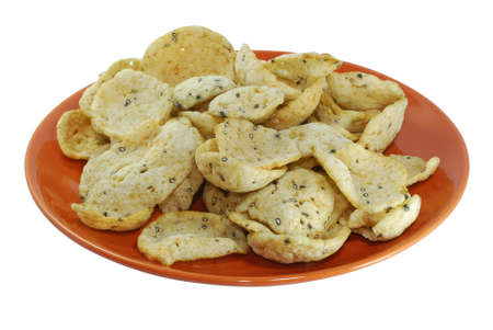 Fish crackers in plate isolated on white background