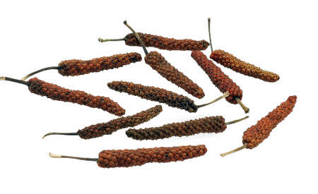 Dry long pepper isolated on white background