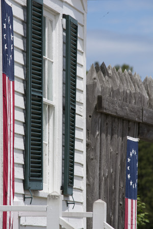 window and shutters with flags