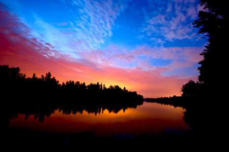 sunset on river Banco de Imagens