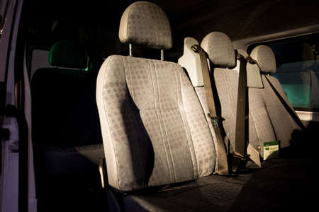 back seat: seats inside of a car, beautiful colors and light Stock Photo