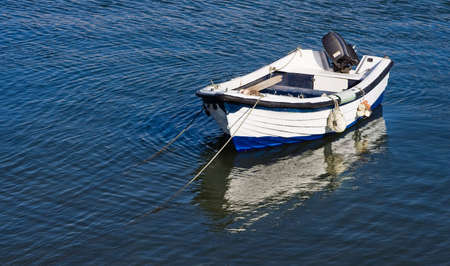 Boat at sunset on the portugal coast, in the Lagos ford. Stock Photo - 4554054