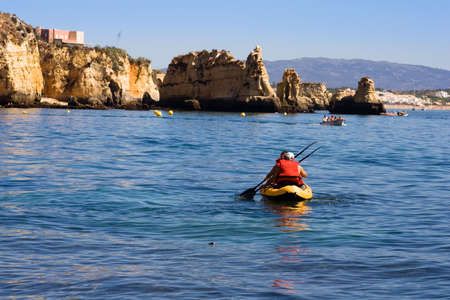 two persons are kayaking in sea,ocean at the morning