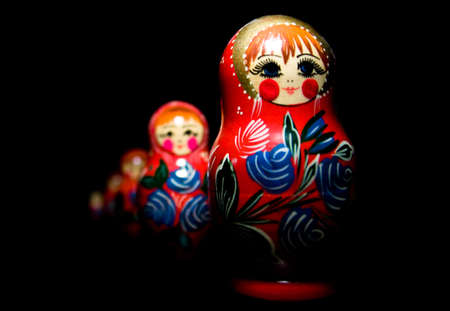matryoshka doll: Russian national babushka matroschka on black background Stock Photo