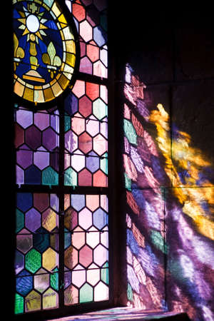 stained glass church: sunlight shining throw colored window