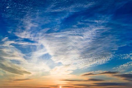 buttom: photo of sunset sky with sun at buttom of the picture Stock Photo