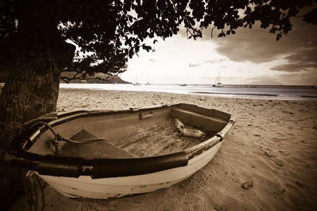 boat on a beach with ocean in the background Stock Photo - 5413937