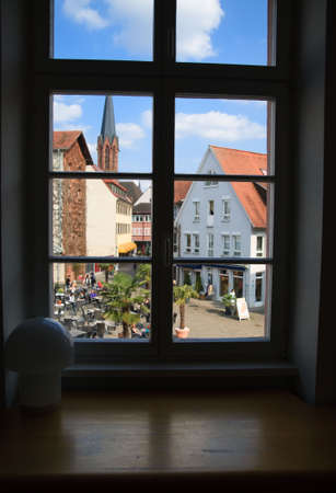 view through window on city center with a church photo