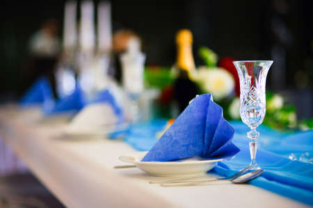 Wedding table set with glasses and small wrapped present