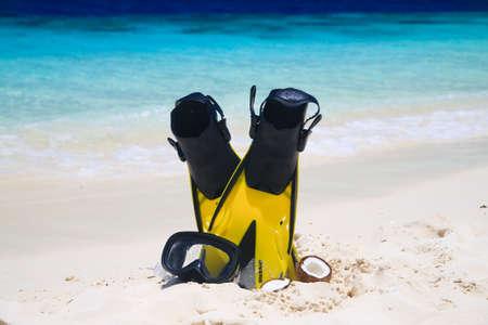 snorekl equipment on white sand beach at Maldives