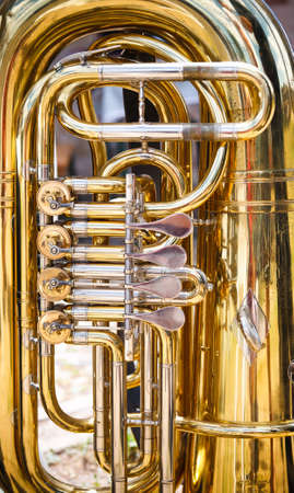 Tuba is a musical instrument made of brass photo