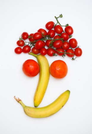 face made of fruits on wooden background Stock Photo - 9333985