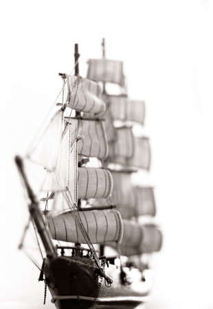 Photo of a model of ship with sails photo