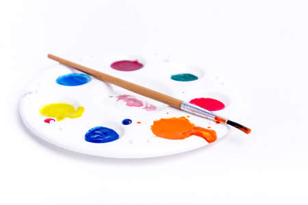Palette and brushes  Paintbrush and palette on white  photo