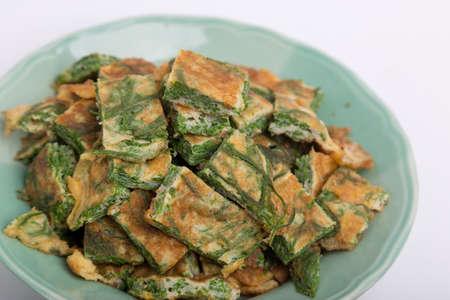 pennata: Fried Acacia Pennata with beaten egg chaom kai in Thai