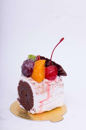 Cakes chocolates fruit. photo