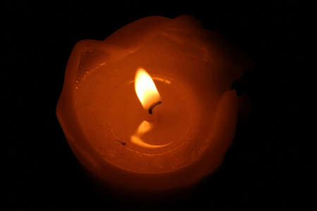 candle flame: One candle flame at night closeup  isolated.