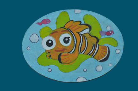 clownfish: childrens Art. drawing clownfish on wood