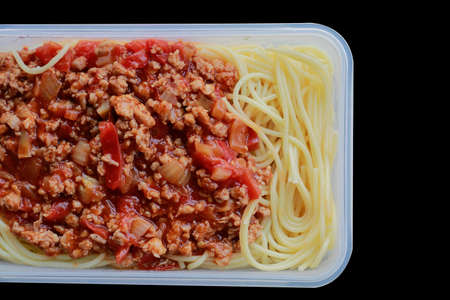 Spaghetti with plastic box, on black. Microwave Dinner