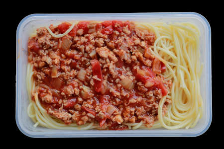 Spaghetti with plastic box, on black. Microwave Dinner