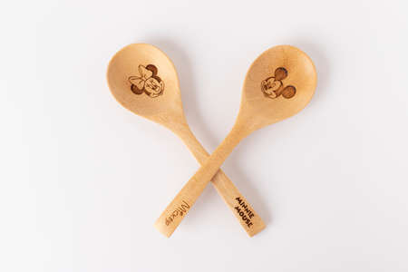 Minnie and Mickey Mouse 'wood Spoon' Disney on white background. Stock Photo