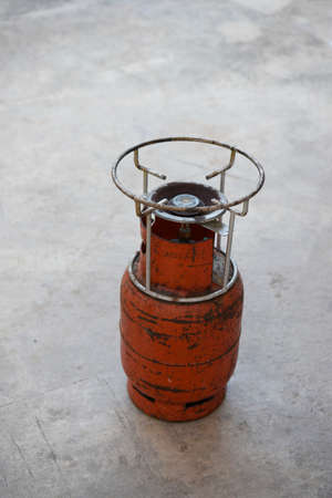 Red Grungy Liquefied Petroleum Gas (LPG) Cylinder.