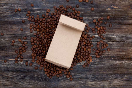 Coffee beans and craft paper bag mockup Stock fotó
