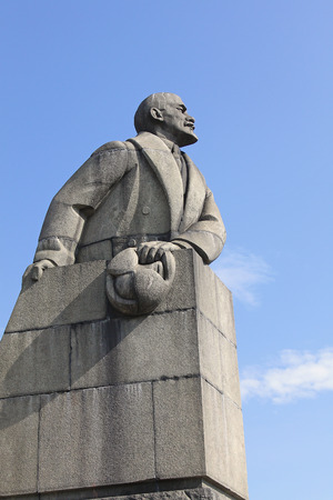 totalitarianism: Monument to Lenin with earflaps in hand. Petrozavodsk, Russia Editorial