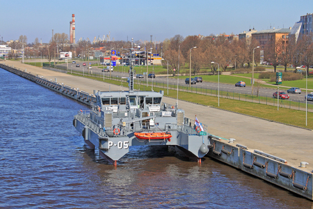 fare: RIGA, LATVIA - CIRCA APRIL 2011: Patrol ship \Skrunda\. The ship is built in SWATH (Small Waterplane Area Twin Hull) technology, being the first SWATH military ship not only in Latvia, but in Europe and the World.