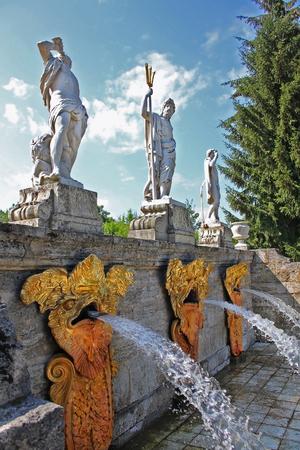 bacchus: The statue of Triton, Neptune and Bacchus.  Fountain \Gold Mountain\ in Peterhof, Russia