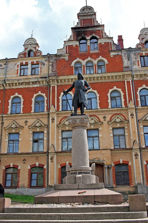 constable: Vyborg, Russia - July 19, 2016: Monument to Torgils Knutsson near the building of the Old town hall. Torgils Knutsson was constable, privy council, and virtual ruler of Sweden during the early reign of King Birger Magnusson (1280â1321). Editorial