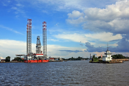 Kronstadt, Russia - 10 July 2016: Jack-up floating drilling rig Arcticat the pier of Kronstadt marine plant. Designed for offshore drilling of exploratory and production wells. Editorial