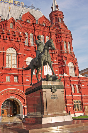 Moscow, Russia - 14 July 2017: Monument to Marshal Zhukov on the background of the Historical Museum. Sculptor Vyacheslav Klykov portrayed the Marshal at the time of receiving the parade in honor of Victory in the great Patriotic war, held on red square o