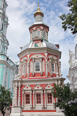 gods: Sergiyev Posad, Russia - 15 July 2017: Assumption chapel over the well in Trinity Sergius Lavra. Built in the late 17th century