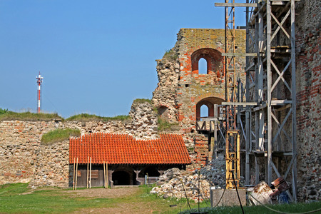 Bauska, Latvia - 6 July 2012:  Ruins of the 15th century castle. The inner courtyard of the unrestored half of the Castle