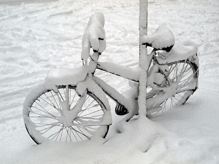 winter storm: Bicycle in the snow