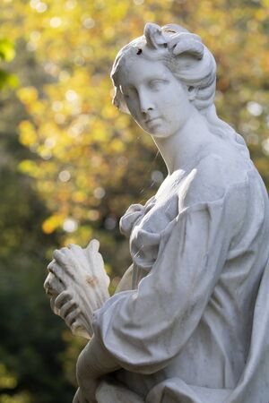 ancient greek statue in park at sunny day Stock Photo