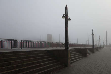 Berlage Bridge at the Amstel river in Amsterdam, The Netherlands in the mist Imagens