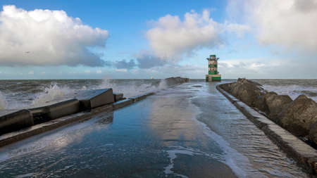 Lighthouse on the pier of Ijmuiden in the Netherlands
