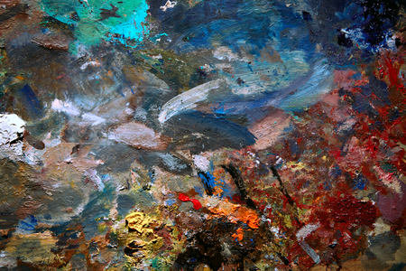 Background image of bright oil-paint palette close up.
